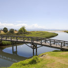 Picture - Bridge and stream leading into the ocean near Whitianga.