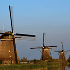 Picture - Windmills along the water at Kinderdijk.