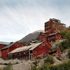 Picture - The red, abandoned factories of the historical Kennecott Copper Mine in the Wrangell Mountains.