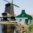 Picture - A windmill on the river of Zaanse Schans.