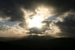 Picture - Sunlight through the clouds in the countryside near Coniston.
