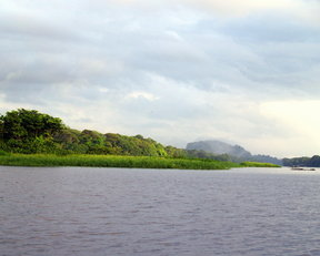 Picture - View to a distant volcano beyond Tortuguero's main channel.