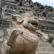 A lion sculpture guarding the stair entrance to the top of Borobudur.