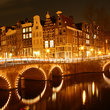 Bridge and city at night, Amsterdam.