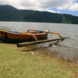 Boat on the shore of Lake Beratan on Bali.