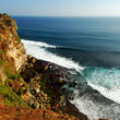 Waves crashing below cliffs on Bali.