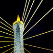 Top of a suspension bridge at night in Bangkok.