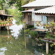 Thai homes on a canal in Bangkok.