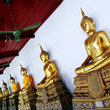 Row of golden Buddhas at the Thawon Wathru building (formerly the Hor Phra Samut Vajiravudh library) in Bangkok.