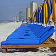 Bright Chairs and Umbrellas on the Beach.