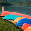 Brightly colored rental boats in a Pennsylvania state park recreational area.