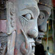 Carved faces in Jakarta.