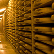 Comte cheese wheels in storage in Switzerland.