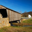 Covered Bridge leads to rural church.