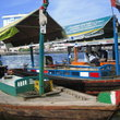 Small boats still play a useful role to ferry passengers at Abra Station, Dubai.