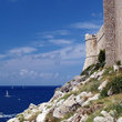Jagged rocks encircle the outer walls of old Dubrovnik.