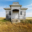 Facade of weathered building on North Dakota grassland.