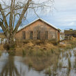 Flooded pastures and buildings on Svensen Island, Oregon.