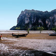 Long boats park on the mud flats and wait for the tide to come back in near Phra Nang beach.