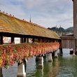 Tower and bridge with flowers in Lucerne.