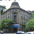 Gresham Assurance Building in Mumbai has basalt façade, two grand pillars plus dome.