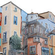 Mural painted houses in Pezenas.