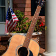 Guitar propped on a front porch of a home in Nashville, Tennessee.