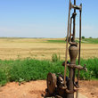Old pump in Oklahoma wheat field.