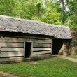 Pioneer cabin in the Tennessee forest.