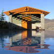 Poolhouse reflected in pool, Oregon Desert.