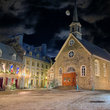 A stone church and buildings in the old town of Quebec City.