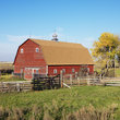 Red barn with fence in North Dakota.