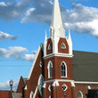 Red brick church with white steeple in Tennessee.