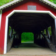 Red covered bridge in rural Vermont.