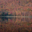 Reflection of Fall colors in Vermont lake.