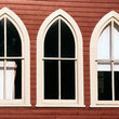 Restored victorian schoolhouse with arched windows.
