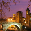 Bridge over the Tiber River at night in Rome.