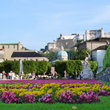 Castle in Salzburg with flowers in foreground.