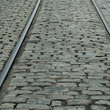 Tracks and cobblestone on River Street, Savannah.