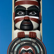 Northwest coast native-American totem poles in downtown Seattle park.