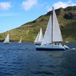 Small sailboats racing in Hawaiian Bay.