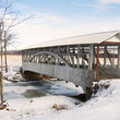 Snow on covered bridge in Osterburg, Pennsylvania.