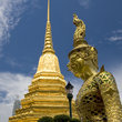 Statue and Golden Chedi at Wat Phra Kaew.