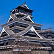 The ornate roof design of Kumamoto Castle on Kyushu Island.