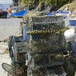 Traps in Cadgwith harbor and Port Cornwall.