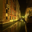 Night time on a canal in Venice.