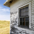 Weathered building on the North Dakota grassland.