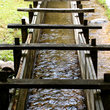 Wooden chute carries water down the line in the Tennessee forest.