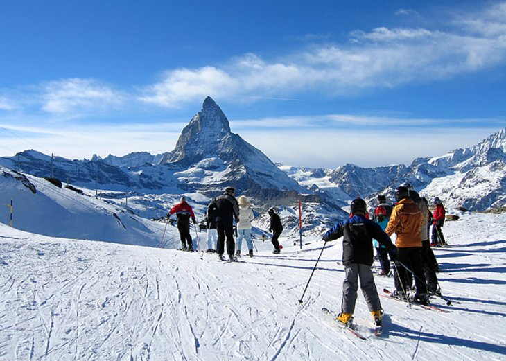 Skiers in front of the Matterhorn