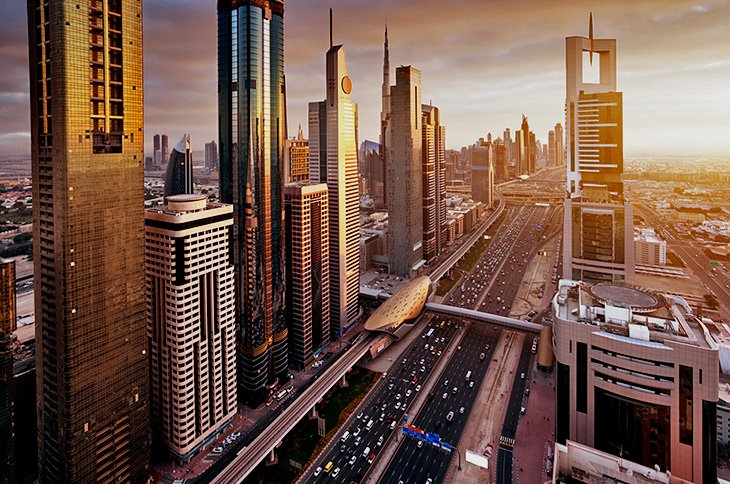 Dubai skyline at sunset where to stay in dubai: best areas & hotels, 2018 Where to Stay in Dubai: Best Areas & Hotels, 2018 united arab emirates dubai where to stay luxury dubai skyline